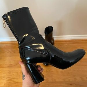 Tight black ankle boots